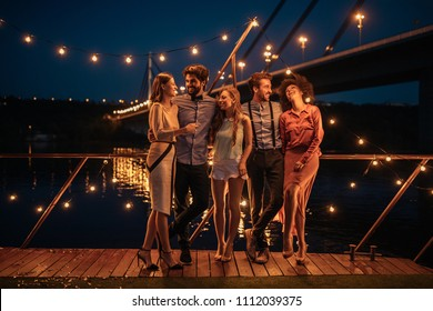 Shot of a group of friends having a great time at a boat party