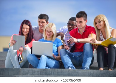 Shot of a group of smiling university students looking at someth
