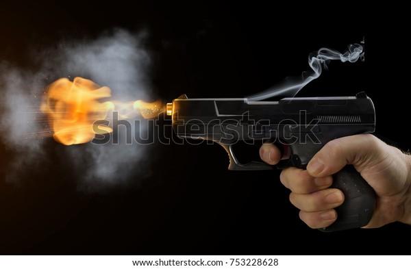 shot gun black fire smoke black background sparks flight bullets hand finger presses trigger