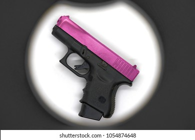 Shot gun or pistol in black color grip part and pink chrome slide barrel,use 9 mm ammunition with magazine grip accessory
