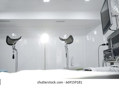 Shot of a gynecological room with chair for medical examinations and equipment medicine feminine health profession clinical hospital examine concept.