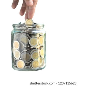 A shot of hand putting or picking the Thai Baht 10 baht coin from the glass jar isolated on white background with clipping path, refer as saving money