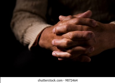 A shot of hands of an old man praying