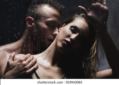 Shot of a handsome man taking a shower with his girlfriend and kissing her on the neck