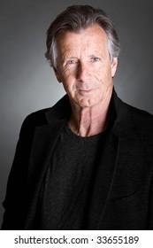 Shot of a Handsome Senior Man against a Grey Background