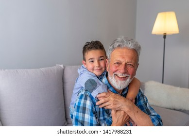Shot of a happy senior man smiling looking at camera his grandson hugging him from behind copyspace relax family love people children retirement vitality lifestyle parenting childhood values weekend