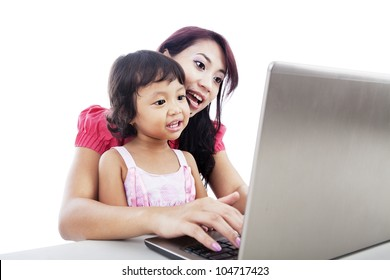 Shot of happy young mother and child with laptop computer