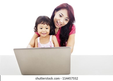 Shot of happy young mother protect her daughter to enjoying entertainment on internet