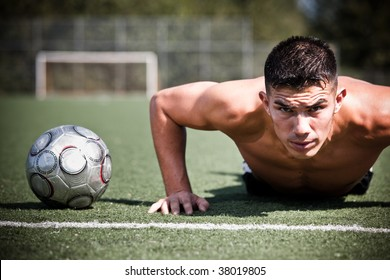A shot of a hispanic soccer or football player doing a push-up