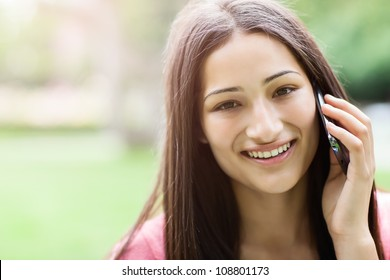 A shot of a hispanic student talking on the phone
