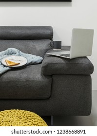 Shot of a laptop on sofa