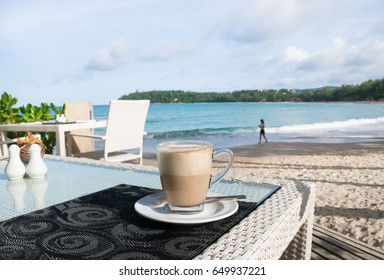 Shot of Latte Coffee cup on beautiful  table by the beach.