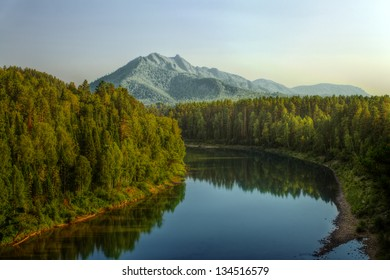 The shot of of Lebed river and Solop mountain in Turochak village (Russia, Altai Republic)
