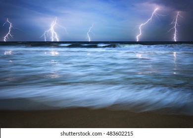 Shot of a lightning strike in the sea during a thunderstorm with heavy rain.
