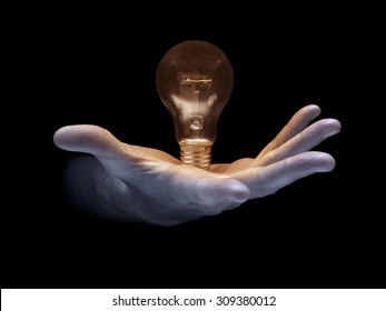 shot of a lit light bulb being held in a mans hand signifying the offering of new ideas