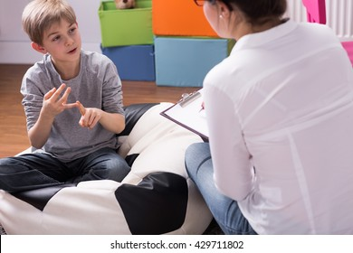 Shot of a little boy talking to a psychologist