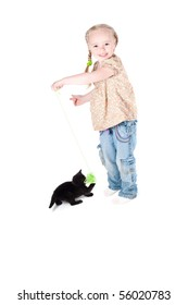 Shot of little cute girl playing with kitten