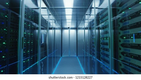 Shot of a long hallway full server racks in a modern data center