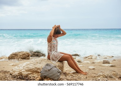 Shot of a lovely satisfied woman enjoying sitting by the sea on vacation.