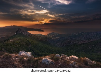 The shot was made in August of 2015 in Elba, a island of Italy. On a mountain during the sunset hours there were visible the village Portoferraio in the distance.