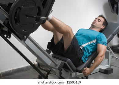 A shot of a male weightlifter doing leg presses.