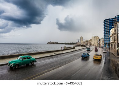 "A shot of the ""Malecon"" in Havana, Cuba. Taken after a rain storm. The Malecon is a famous ocean side road in Havana. Many tourists walk along the shore."