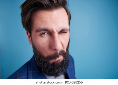 Shot of man with beard winking