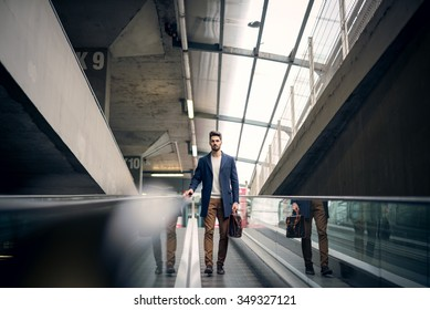 Shot of a man carrying bag and heading up to the office.
