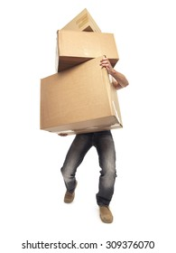 shot of man struggling to carry boxes while moving house