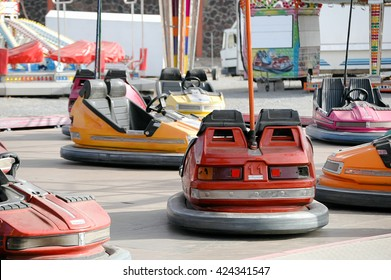 A shot of many bumber cars in a fairground attraction