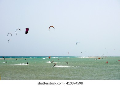 A shot of many kitesurfers and windsurfers in Sotavento Beach, Fuerteventura island