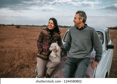 Shot of a middle aged couple enjoying a day in nature with their dog