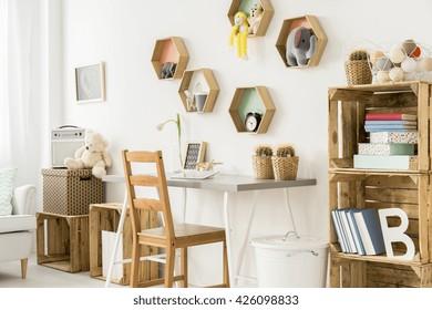 Shot of a modern children's room full of wooden furniture