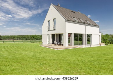 Shot of a modern detached house with a big backyard