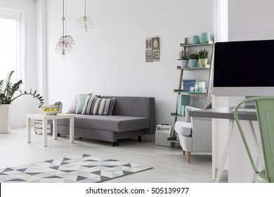 Shot of a modern woman's bedroom with bright wooden floor