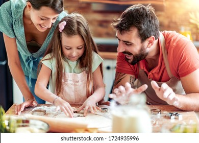 Shot of a mother, father and daughter in the kitchen.