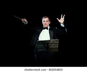 Shot of music director conducting with inspiration