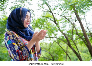 Shot of muslim woman standing , praying portrait.