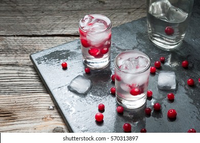 Shot with natural cranberry and vodka, stone background.