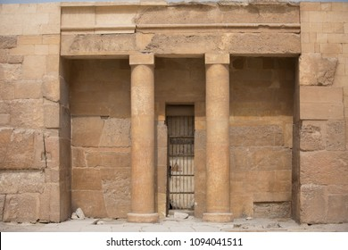 Shot of an old entrance between huge columns of a tomb in the pyramids of Giza