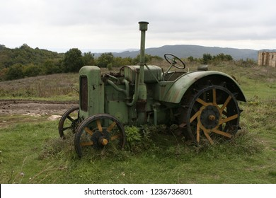 A shot of an old tracktor on a field
