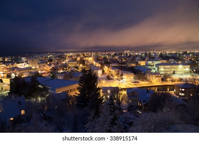 Shot over the Reykjavik area at christmas time, covered in snow with christmas lights and pine trees