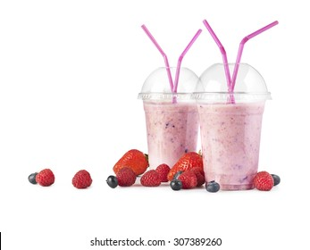 shot of a plastic smoothie cup, isolated on a white background with an array of fruit around the base.