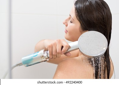 Shot of a pretty young woman taking a shower