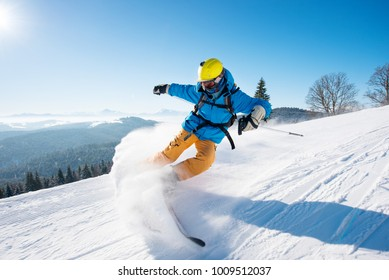 Shot of a professional skier riding the slope on a beautiful winter day copyspace ski resort recreation vacation extreme adrenaline