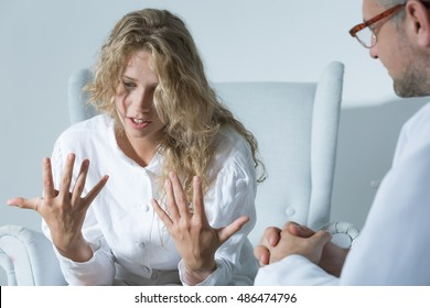 Shot of a psychiatrist listening to her patient's talking