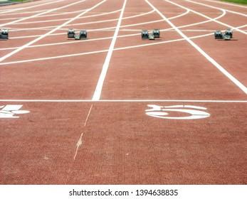 Shot of racing track and starting blocks