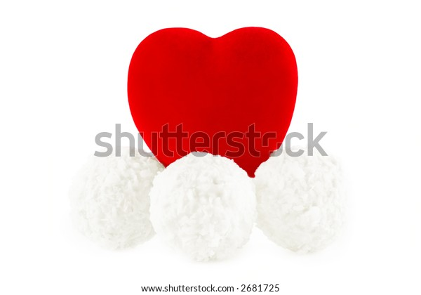 shot of the red heart on the coconut sweets, on a white background with pretty shadow