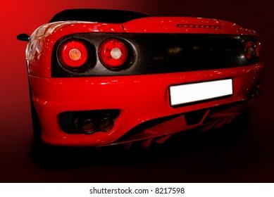 shot  of a red sports car (ferrari)