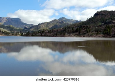 A shot of the reflections in the water in the Chira Dam